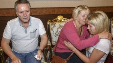 Family members of Hannah Witheridge, one of the two British tourists killed on Koh Tao island, comfort each other at the headquarters of the Royal Thai Police in Bangkok.
