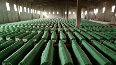 Genocide ... coffins containing the remains of 600 Bosnian Muslims await burial after being exhumed from mass graves near Srebrenica in 2003.  More than 8000 men and boys were killed by units under the command of General Ratko Mladic in and around the Bosnian town in 1995.