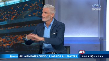 Socceroos great Craig Foster has applauded the AFL's decision to mandate players to be vaccinated