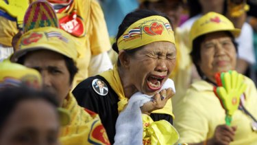 An anti-Government protester reacts to a speech by Thai Prime Minister Samak Sundaravej in which he vows not to resign.