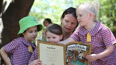 Getting involved … Anna Playford with her daughter Jessica, Finn Bernstone-Harris, left, and Evie Geikowski.