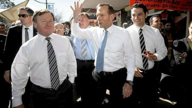 Tony Abbott campaigning with Kent Johns, left.