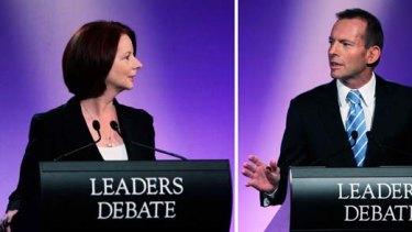 Close call ... Julia Gillard and Tony Abbott during last night's debate.