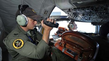 Crew of an RAAF P3 Orion  search for the missing Malaysia Airlines flight MH370.