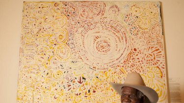 Senior law man and traditional healer Dickie Minyintiri with his winning painting.
