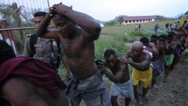 Police arrest attendees of the Third Papuan People Congress in Abepura.