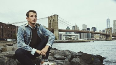 Garth Risk Hallberg takes in the view of the Brooklyn Bridge and Manhattan.