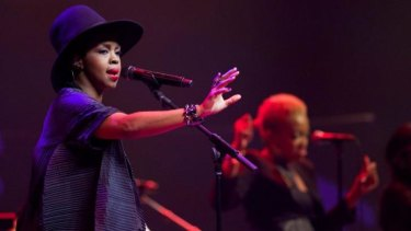Lauryn Hill gestures to the crowd during her Vivid Live gig at the Sydney Opera House on Tuesday night.