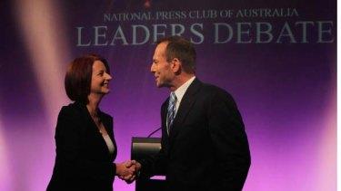 Head to head ... Julia Gillard and Tony Abbott shake hands before yesterday's debate in Canberra.