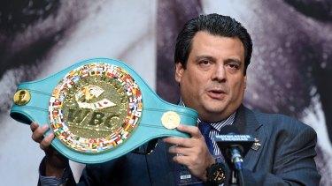 WBC President Mauricio Sulaiman displays a championship belt on offer.