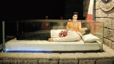 I see dead people … Imelda Marcos beside her late husband Ferdinand's glass coffin.