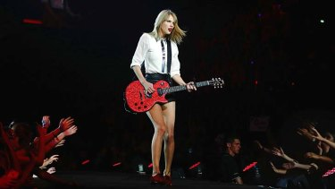"""Megastar: Taylor Swift, queen (and clean) of pop, says ''I just try to stick to living my life the way that I would be proud of if I was looking back when I was older"""". She will tour four cities."""