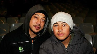 Big shoes to fill ... former All Blacks skipper Tana Umaga and son Cade in the stands at Stade de France in 2006.