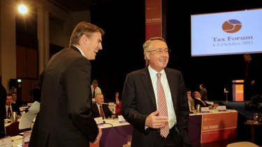 Following the script … Rob Oakeshott and the Treasurer, Wayne Swan, share a joke during a break at the summit.