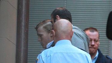 Matthew Milat, left, arrives at the NSW Supreme Court this morning before being sentenced to 43 years in jail for murder.