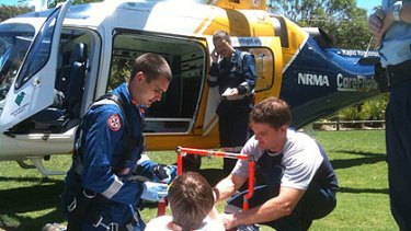 Harry Keighery about to be flown to hospital for surgery after the accident.