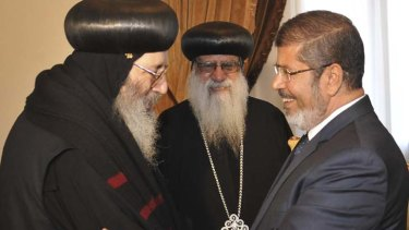 Welcome ... Mohammed Mursi with Coptic bishops.