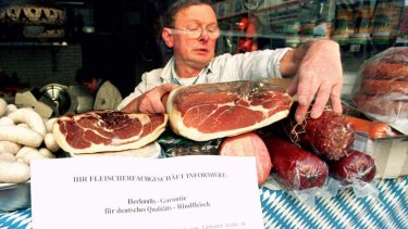 For the chop ... a Hamburg butcher with a notice guaranteeing meat origins in 1996. Beef labelling laws to control the spread of BSE resulted in the formation of one of the longest words in German.