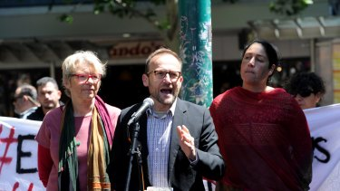 Federal Member for Melbourne Adam Bandt  addresses protesters at the rally.