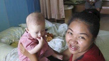 Pattharamon Janbua holds Gammy in a Thailand hospital on Sunday.