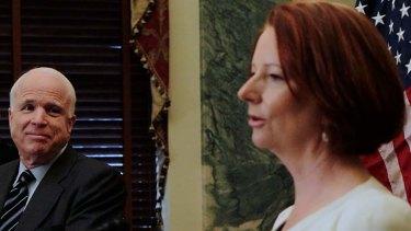 US Senator John McCain looks on as Australia Prime Minister Julia Gillard speaks.