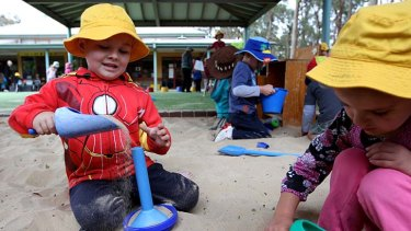 On his way … Gary, who is in the Ngroo program, plays with his friend Abbygail at Grays Lane Children's Centre in Cranebrook.