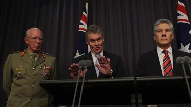 Duncan Lewis (centre), secretary of the Defence department, will leave the role after only a year.