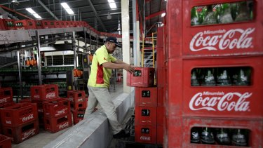 Coca-Cola Amatil is discounting the price of  carbonated soft drinks and bottled water to boost weak volumes.