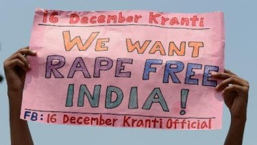 A protester holds up a sign promoting Indian anti-rape advocacy group 16 December Kranti.