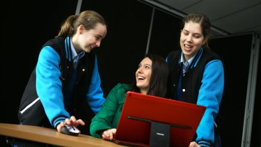 Frankston High students Emily Smith (left) and Bridin Walker with teacher Sarah Toovey.