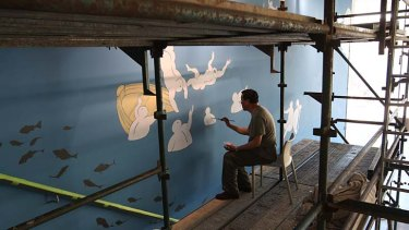 Revamp: Guan Wei installs his mural <em>The Journey to Australia</em> on the stairs of the Museum of Contemporary Art.