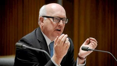 George Brandis appears before the legal and constitutional affairs committee.