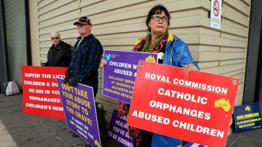 Protesters at the Royal Commission into Institutional Responses to Child Sexual Abuse in Ballarat Magistrate's Court on Tuesday.