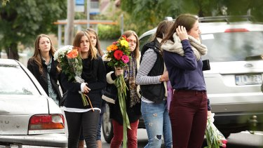 Friends and mourners gather at the scene of the crash in Westgarth Street to lay flowers.