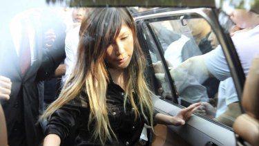 Singaporean pop music singer Ho Yeow Sun, popularly known as Sun Ho, gets in a car as she leaves the Subordinate Courts in Singapore in file photo from June 2012.