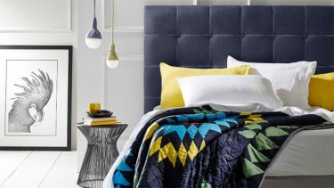 Hugo bedhead covered in a charcoal blue linen teamed with a white saddle stitch.