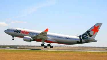 Angry passengers have held a Jetstar crew hostage after a flight delay in China.