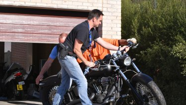 Police, including detectives from Echo taskforce, seizing assets in Comanchero bikie gang raids.