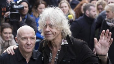 Please stop ... Musicians Midge Ure (left) and Bob Geldof attend the recording of the Band Aid 30 charity single in west London, November 15.