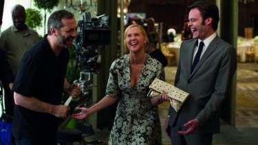 Director Judd Apatow, Amy Schumer and Bill Hader during the shooting of <i>Trainwreck</i>.