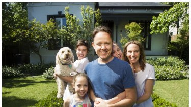 Matt Mullins with his family, Tom (holding Buddy the dog), Lulu (front), Sophie (obscured) and Cait.