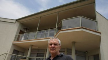 From the ashes...Phillip Moore and the home he rebuilt to withstand bushfires.
