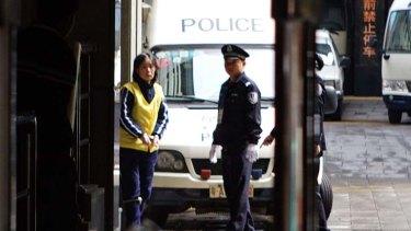 Charlotte Chou outside the court in Guangzhou.