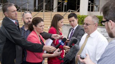 Defence lawyer Michael Bosscher speaks to the media.