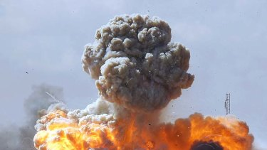 Air strike ...  pro-Gaddafi troops are bombed by coalition forces on the road between Benghazi and Ajdabiya.