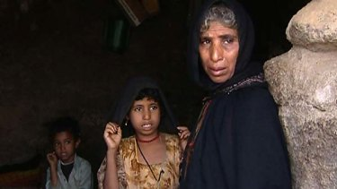 Nejma, mother of Yemeni child bride Ilham al-Ashi, stands with two of her other children.
