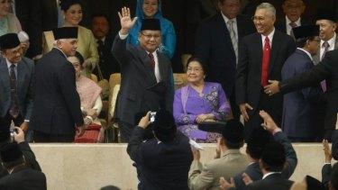 Mr Joko's rival for the presidency, Prabowo Subianto, attended the  ceremony.
