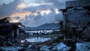 World Bank chief sees climate change intensifying storms such as typhoon Haiyan.