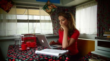 "Finding the words: Tara Moss in the 1970s caravan, ""Betty"", where she sometimes works."