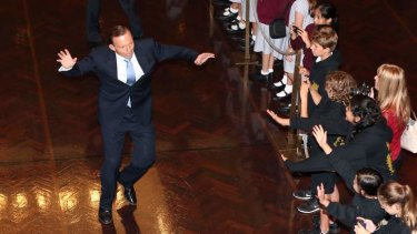 Prime Minister Tony Abbott gives an enthusiastic welcome to school children in the Great Hall. Photo: Alex Ellinghausen